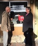 Paul Edwards, President of Let's Live Local presenting check for defribllator to Pine Mountain Health Center
